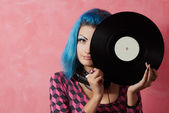 Punk girl DJ with dyed turqouise hair — Stock Photo
