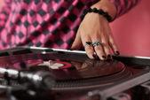 Hands of female DJ mixing music — Stock Photo