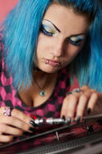 Punk girl DJ with dyed turqouise hair — Stok fotoğraf
