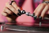 DJ fitting needle to turntable tonearm — Stock Photo