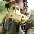 Young soldier in helmet targeting - Stock Photo