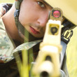 Portrait of soldier in helmet targeting — Stock Photo