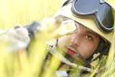 Young soldier in helmet targeting — Stock Photo