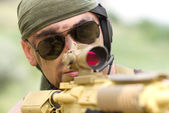 Soldier in sunglasses targeting — Stock Photo