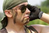 Soldier in a headset talking — Stock fotografie