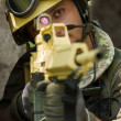 Portrait of a soldier targeting with a rifle — Stock Photo