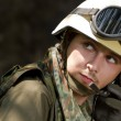 Soldier in helmet talking on a headset — Stock Photo