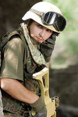 Soldier in helmet talking via headset — Stock Photo