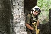 Soldier in helmet talking on a headset — Стоковое фото
