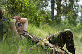Soldier takes rest lying on a grass — Stock Photo