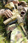 Soldier takes rest holding a rifle — Stock Photo