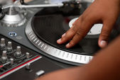 Hip-hop DJ scratching the record — Stock Photo