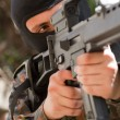 Stock Photo: Soldier in black mask with a gun