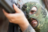 Terrorist in balaclava mask with a gun — Stock Photo