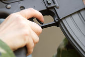 Finger on a trigger — Stock Photo