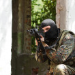 Terrorist in black mask with a gun — Stock Photo #11950950