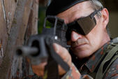 Old soldier with a gun — Stock Photo