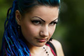 Pierced young girl with blue hair — Stock Photo