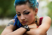 Sad punk girl posing outdoors — Stock Photo