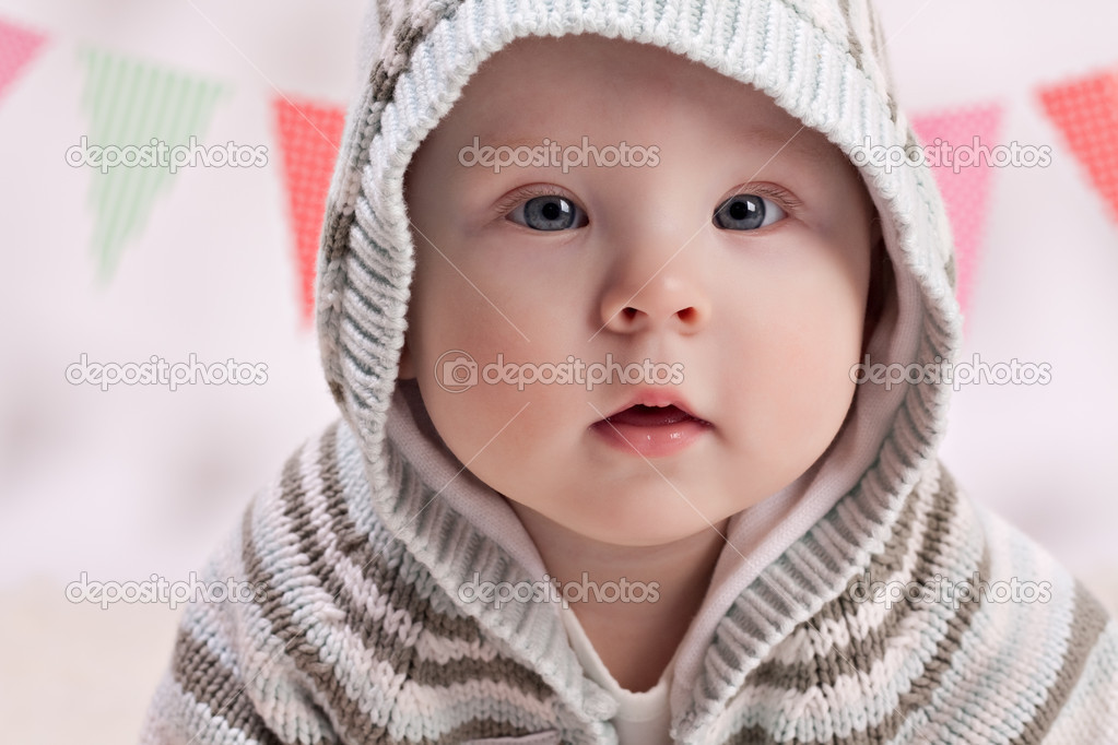 Beautiful little baby boy looking at camera — Stock Photo #10954021