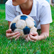 Boy with old soccer ball — Stock Photo