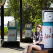 Girl at gas station — Stock Photo #11530020