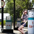 Girl at gas station — Stock Photo #11530037