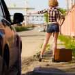 Blonde girl hitchhiker — Foto de Stock