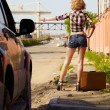 Blonde girl hitchhiker — Stock Photo