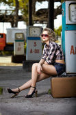 Girl at gas station — Stock Photo