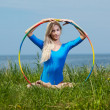 Stock Photo: Blonde girl gymnast outdoors
