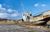 Boat in frozen baikal — Stock Photo