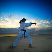 Karate on sunset beach — Stock Photo