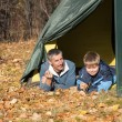 Tent in autumn forest — Stock Photo #11338721