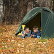 Tent in autumn forest — Stock Photo #11688915