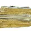 Stack of old newspapers isolated — Stock Photo