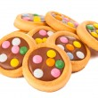Biscuits with milk chocolate and coloured chocolate beans - Stockfoto
