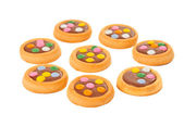 Biscuits with milk chocolate and coloured chocolate beans isolat — Stock fotografie