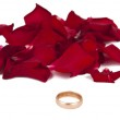 Engagement ring with rose petals isolated — Stock Photo