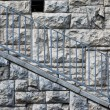 Stock Photo: Stone wall with blue railings