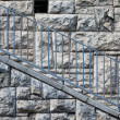 Stone wall with blue railings - Stock Photo