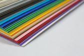 Edge of the stack of colored paper — Stock Photo