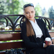 Businesswoman on bench — Stock Photo
