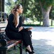 Businesswoman on bench - Stock Photo