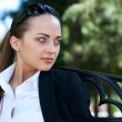 Businesswoman on bench — Stock Photo #11347822