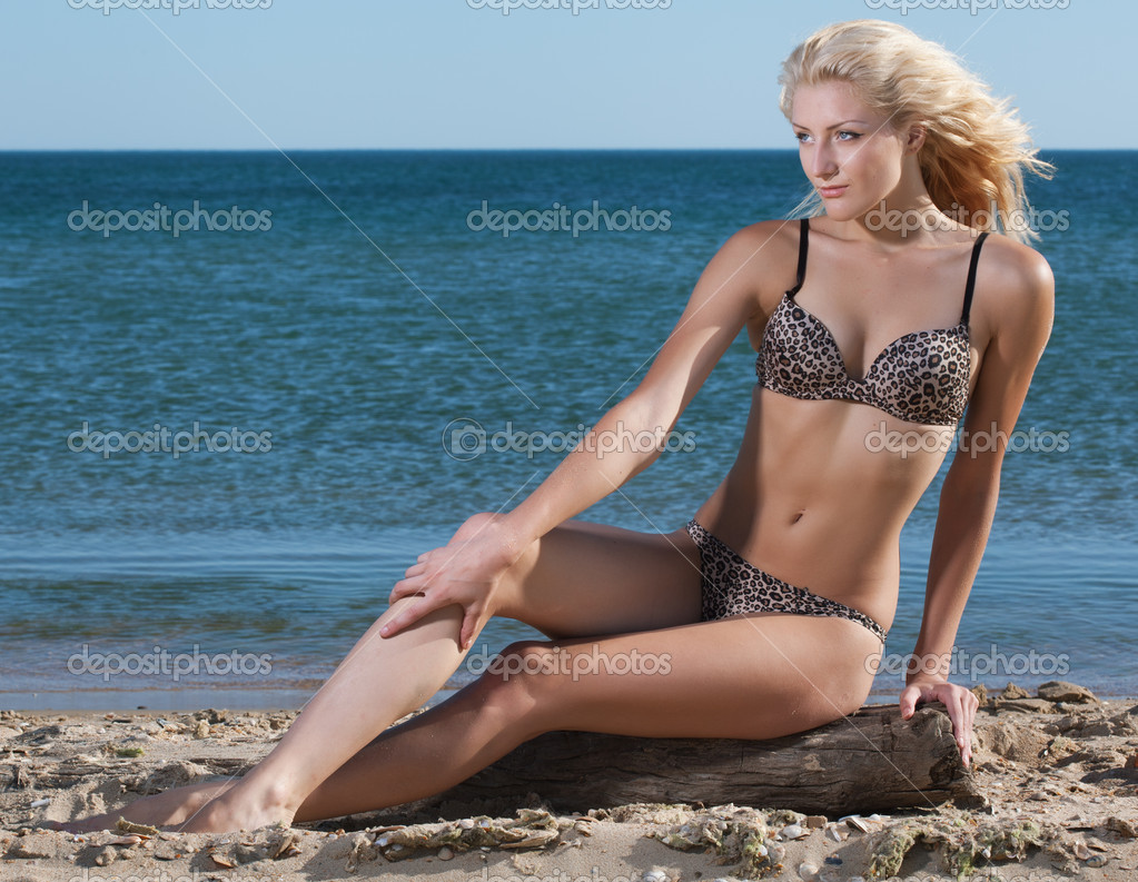 Beauty sexy woman on beach in bikini  Stock Photo #11415523