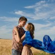Stock Photo: Loving couple on wheat field