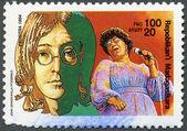 MALAGASY REPUBLIC - 1994: hows John Lennon, Ella Fitzgerald (1917-1996) — Stock Photo