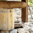 Stock Photo: Detail of draw well with wooden bucket