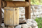 Detail of draw well with wooden bucket — Stock Photo